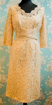 Sale 8448A - Lot 99 - Stunning 1950s ecru lace illusion formal/wedding dress, featuring beautiful floral 3/4 sleeve lace design, large flattering criss-c...
