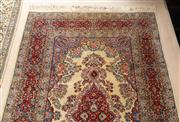 Sale 8650A - Lot 11 - A Persian wool carpet the red medallion with pendants on a cream field, 218 x 141cm.