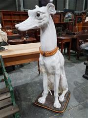 Sale 8714 - Lot 1001 - Large Probably Italian Ceramic Greyhound, with yellow collar & seated on cushion (some restoration to tail area)