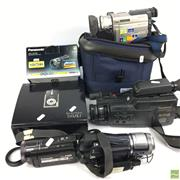 Sale 8648A - Lot 26 - Group of Video Cameras Together With Digital Camera