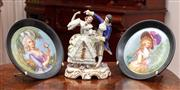 Sale 8804A - Lot 80 - A porcelain crinoline group together with a pair of portrait plates, tallest 23cm