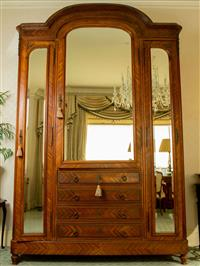 Sale 8392H - Lot 78 - A French arch top wardrobe with bevelled mirror doors and four drawers, inside shelved and fitted with electrical capabilities, H 25...