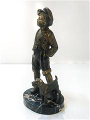Sale 8516A - Lot 1 - A charming Art Deco era bronze & mercury gilt statue of a boy & his dog, French, c1920s, on black marble base with exotic vein / gr...