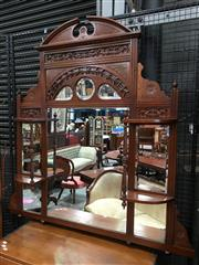 Sale 8666 - Lot 1037 - Victorian Walnut Overmantle Mirror, with broken arch cornice, above a central and subsidiary partially shaped mirrors flanked by she...