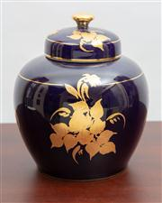 Sale 8774A - Lot 82 - A Limoges lidded vase hand painted by Lillian with a gilt flowers on a deep blue ground, H x 22cm