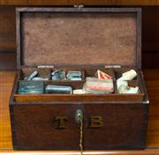 Sale 8342A - Lot 7 - An antique fishermans kit, in cedar W30, inscribed in gilt lettering T.B, with floating compartment, contents to include weights, h...