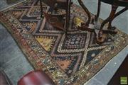 Sale 8335 - Lot 1040 - Antique Persian Wool Carpet, identified as Bakhtiari by label, with repeating hooked guls on dark ground, within serrated leaf borde...