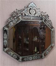 Sale 8650A - Lot 14 - A Venetian style octagonal mirror surmounted by crest with engraved detailing, H 100 x W 105cm.