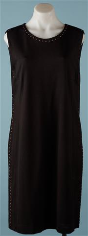Sale 9090F - Lot 88 - A MARC CAIN BLACK SHEATH DRESS; having metal highlight studs to the neckline and side seams, size N4.