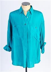 Sale 8926H - Lot 65 - A Compagnie Internationale Express silk blouse in dark cyan, size M