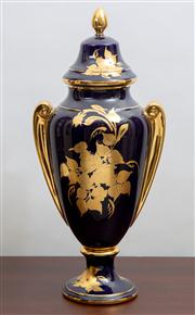 Sale 8774A - Lot 83 - A twin handled lidded trophy form vase with gilt flowers and decoration H x 54cm