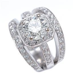 Sale 9213 - Lot 399 - AN IMPRESSIVE 18CT WHITE GOLD DIAMOND RING; centring a round brilliant cut diamond estimated in the setting as 3.04ct, J - K/ SI cla...
