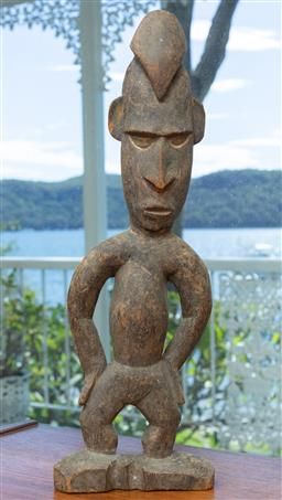 Sale 9164H - Lot 98 - A PNG carved timber figure, Height 43cm