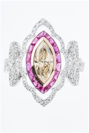 Sale 8299J - Lot 398 - A DIAMOND AND RUBY DRESS RING; centring a marquise cut champagne diamond estimated as 0.90ct encircled by carre cut rubies to border...