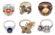 Sale 9037 - Lot 326 - SIX SILVER AND GILT RINGS; set with a glass intaglio, cabochon amber coloured paste, a large zirconia with articulating spider, a by...