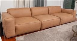 Sale 9150H - Lot 21 - A tan leather three sectional sofa, Height of back 70cm x total Width 300cm x Depth 102cm
