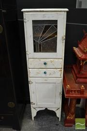 Sale 8489 - Lot 1007 - Slim Kitchen Cabinet with Single Leadlight Door