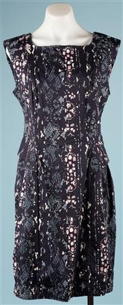 Sale 9090F - Lot 77 - A FRENCH CONNECTION PEPLUM DRESS; in a lacey geometric pattern in pinks, blues and black, size