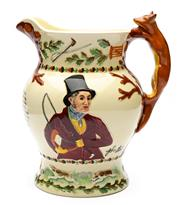 Sale 8599A - Lot 48 - An English Crown Devon pottery John Peel jug with fox handle, embossed decoration and verse, fitted with a Swiss musical work to the...