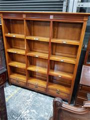 Sale 8714 - Lot 1033 - Large French Style Cherrywood Bookshelf, with three bays bearing brass label holders & three drawers to base