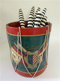Sale 9142A - Lot 5007 - Vintage hand-painted Childs drum containing 8 striped calisthenics skittles: drum 35cm x 31cm; skittles length 33 - 51 cm.