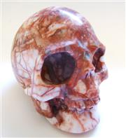 Sale 8312A - Lot 80 - A carved rouge marble skull paperweight, size 7 x 8 cm