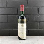 Sale 8987 - Lot 696 - 1x 1971 Chateau Mouton-Rothschild, 1er Cru Classe, Pauillac - level at mid shoulder, cellared stained label