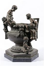 Sale 9010 - Lot 4 - Classical Style Bronze Urn Decorated With Five Clambering Putti H: 45cm