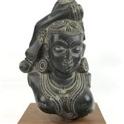 Sale 8699A - Lot 741 - Indian Black Basalt Carved Dancing Devi Bust on timber stand, height 25cm