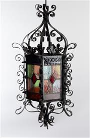 Sale 8775 - Lot 17 - A black painted wrought metal and stained glass hexagonal hanging lantern, French circa 1900, height of drop 80cm