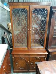 Sale 8868 - Lot 1148 - Victorian Figured Walnut Bookcase, with two arched (later leadlight) doors, with two carved oval medallion doors below