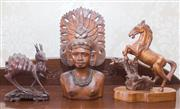 Sale 8375A - Lot 52 - Three carved timber items including a Filipino in headdress, a rearing horse, and a doe