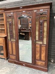 Sale 9085 - Lot 1058 - Late Victorian Carved & Figured Walnut Wardrobe, with full length mirror door, flanked by subsidiary doors with carved grotesques &...