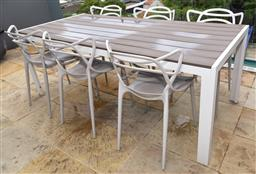 Sale 9150H - Lot 28 - An outdoor rectangular table, together with six replica Honcho chairs (after a design by Phillip Starcke) Height 74.5cm x Width 200c...