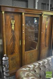 Sale 8335 - Lot 1055 - Empire Style Mahogany Bibliotheque Bookcase, with central glass panel doors flanked by two timber panel doors with victory type figu...