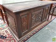 Sale 8485 - Lot 1037 - 17th Century Style Carved Oak Coffer, with hinged top & floral motifs