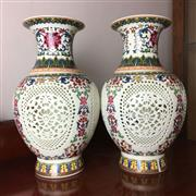 Sale 8795K - Lot 254 - A pair of polychrome Chinese pierced two-section vases