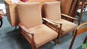 Sale 8395 - Lot 1012 - Pair of Upholstered Teak Framed Chairs with Paddle Arms