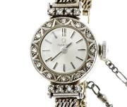 Sale 8426 - Lot 384 - OMEGA 18CT WHITE GOLD & DIAMOND LADYS WRISTWATCH; sunburst silver dial with applied markers, bezel and lugs set with single cut dia...