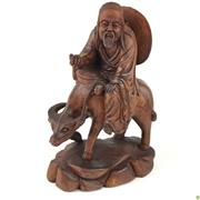 Sale 8562R - Lot 39 - Fine Timber Carving of a Man Riding Buffalo (H: 25cm)