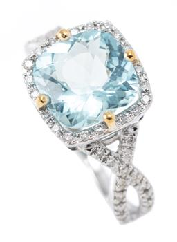 Sale 9169 - Lot 396 - AN AQUAMARINE AND DIAMOND RING; claw set in 9ct white gold with a fancy cushion cut aquamarine of approx. 2.35ct to surround and cro...