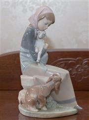 Sale 8375A - Lot 56 - Lladro figure of a girl holding a lamb. 23cm height...