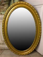 Sale 8795K - Lot 257 - A gilt framed oval shaped mirror