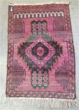 Sale 9112 - Lot 1039 - Red tone carpet with central medallion - damaged (140x99cm)