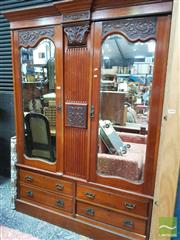 Sale 8428 - Lot 1055 - Edwardian Walnut Wardrobe, with two shaped mirror panel doors, central carved column & four drawers below