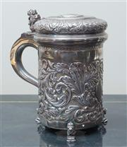 Sale 8562A - Lot 70 - A C19th Continental 900 silver tankard on three seated lion feet, scrolling acanthus and vacant cartouche decoration, with a lion ra...