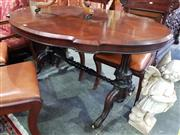 Sale 8774 - Lot 1078 - Victorian Rosewood Occasional or Centre Table, with serpentine shaped top, with turned carved end supports & stretcher