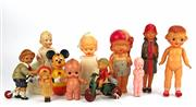 Sale 8330T - Lot 80 - Seven Japanese Celluloid Dolls and others; including figure on tinplate clockwork tricycle with bell, kewpie, hobby horse, together...