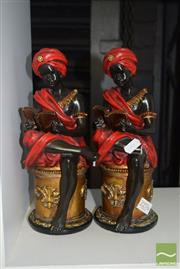 Sale 8509 - Lot 2276 - Seated Pair of Resin Figures Reading A/F