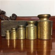 Sale 8795K - Lot 260 - A set of five brass weights